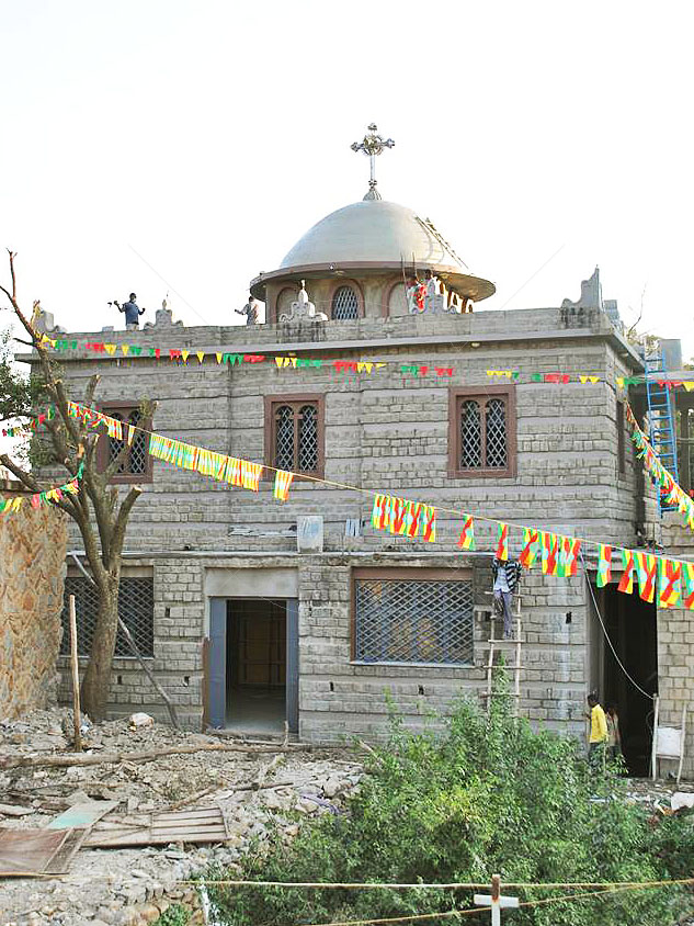 Workmen finish exterior of New Chapel of the Tablet in Aksum Ethiopia