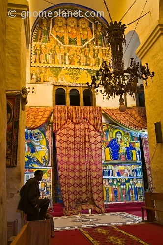 caption: Paintings in the old church of 'St Mary of Zion' and the covered entrance to the inner chapel.