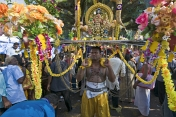 Thaipusam pilgrim with shrine to Lord Murugan decorated with flowers
