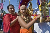 Young boy carries Kavadi burden to take part in the Thaipusam pilgrimage