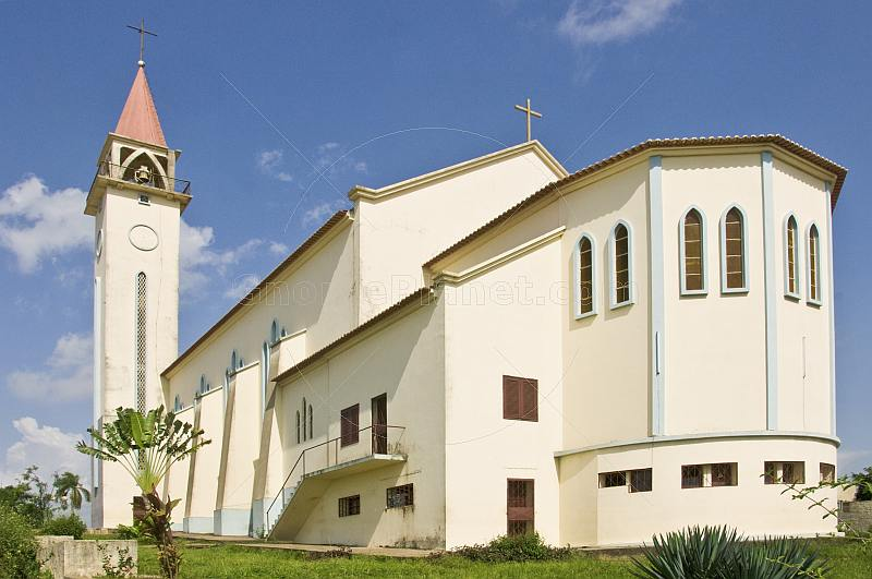 The white stucco Roman Catholic church.