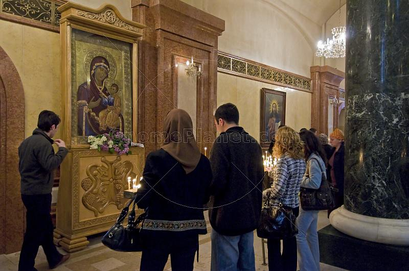 Eastern Orthodox worshippers pray before an icon in the Sameba Cathedral.