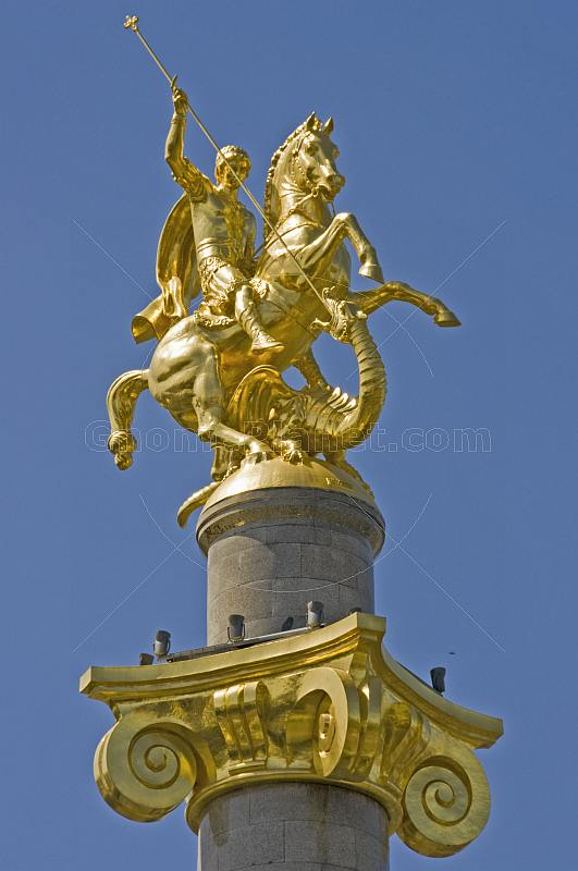 The golden statue of St George killing the Dragon tops the column in Freedom Square.