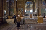 Worshippers pray before the icons in the Eastern Orthodox cathedral.