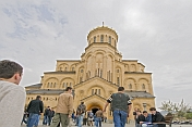Eastern Orthodox worshippers walk to mass at the Sameba Cathedral.