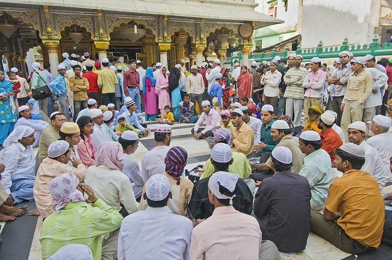 Worshippers in the marble courtyard of the Dargah of Hazarat Nizamuddin.