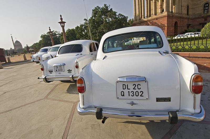 White Ambassador government cars waiting outside the Lutyens-designed North Block Secretariat.