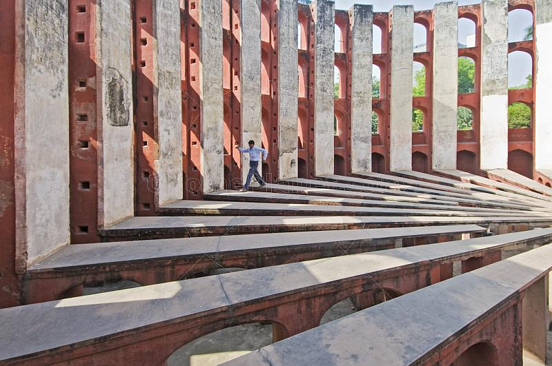 Visitors explore the Ram Yantra, used to measure horizontal and vertical angles of celestial bodies, at the Jantar Mantar observatory on Sansad Marg.