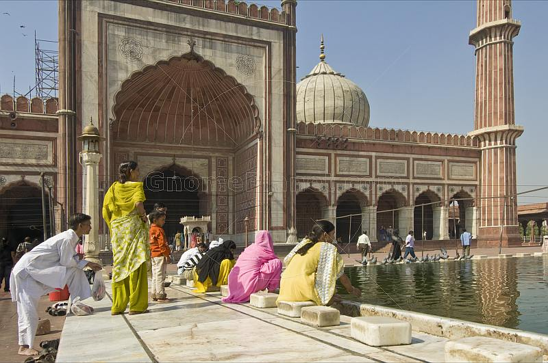 Muslim women perform ablutions before going to pray at Shah Jahan's Jama Masjid mosque.