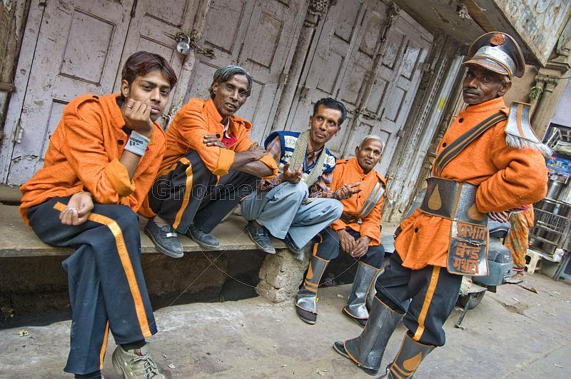 Indian bandsmen in orange uniforms.