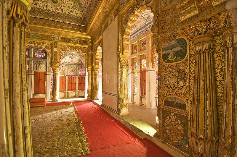 Ornate gilded throne room in the Meherangarh Fort Palace Museum.