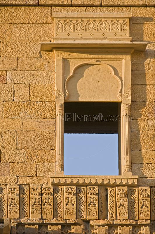 Richly-carved wall and window surround on a havelli in the old quarter.