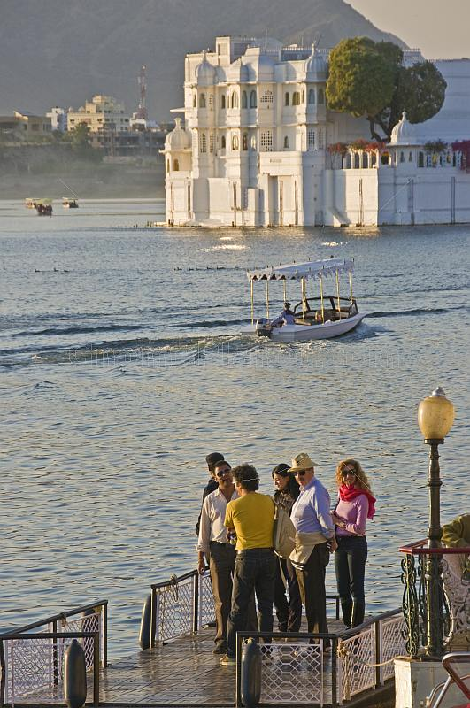 Guests of the Lake Palace Hotel wait for the next launch to take them to Jag Niwas Island.