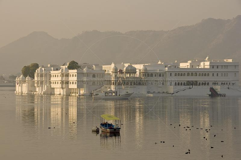 Early morning light illuminates the Lake Palace Hotel on Lake Pichola.