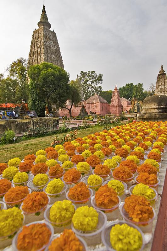 Yellow and orange flowers laid out before the Mahabodhi Temple.