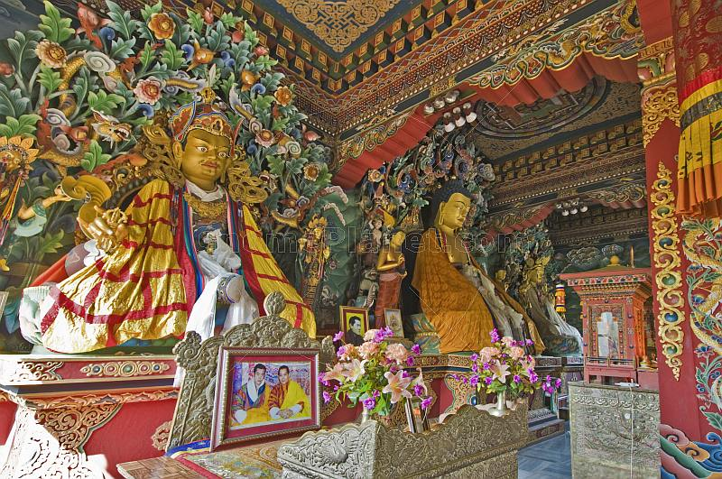 Buddhist statues in colorful robes at the Bhutanese Temple.