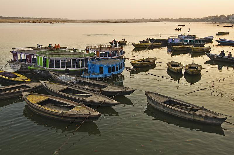 Boats for pilgims on the Ganges River at sunset.