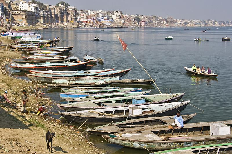 Rowing boats lined up along the banks of the Ganges River.