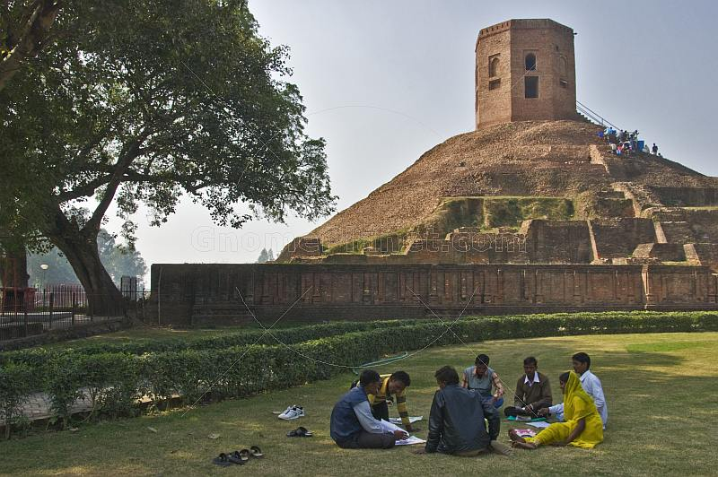 A group of students study in front of the 5thC Chaukhandi Stupa at Sarnath, which has an octagonal tower on top, built by Akbar in 1588.