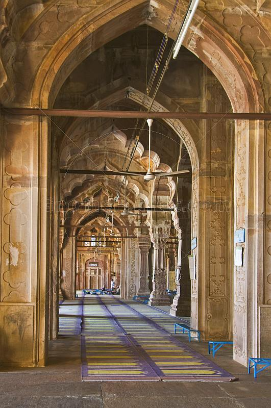 Interior of the Taj-ul-Masjid, one of the largest mosques in India, which was begun by Shah Jehan Begum in 1878 but left unfinished for over a century.