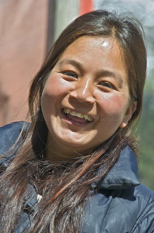 Laughing Lepcha woman.