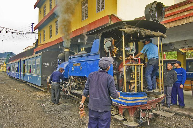 Engineers struggle to get a steam engine on the Darjeeling Himalayan Railway ready for service.