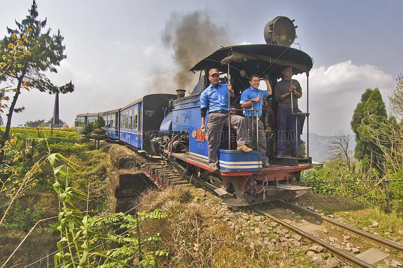 A steam train on the Himalayan Mountain Railway crosses over its own lines at the Batasia Loop.