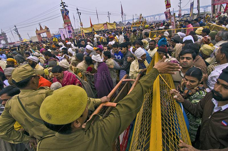 Indian police control the dense crowds at Basant Panchami Snana procession.