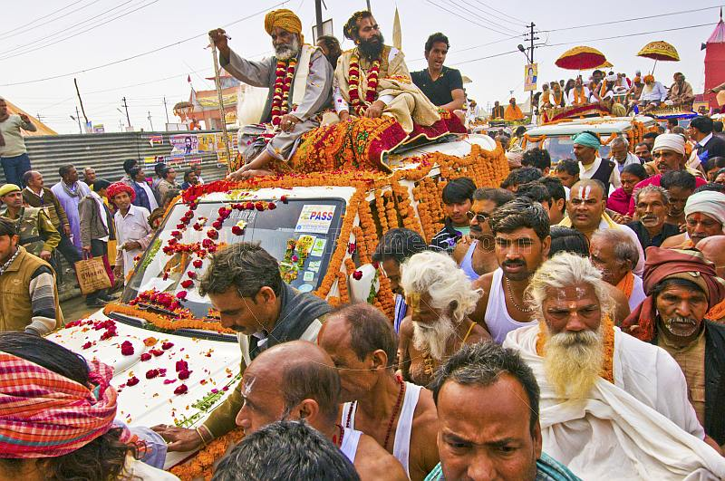 Mass crowds of Hindu Holy Men and jeeps block the Kumbh Mela procession road.