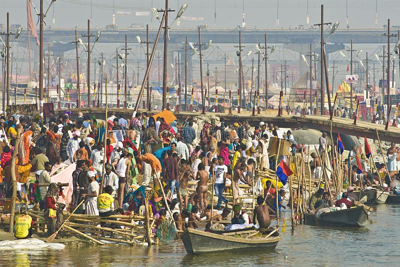 Crowded bathing ghats on the fast-flowing Ganges River at the Kumbh Mela festival.