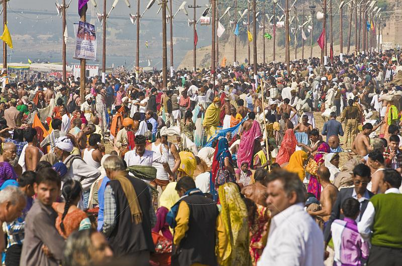 Dense crowds of Hindu pilgrims fill the bathing ghats at the Ganges Yamuna Sangam.