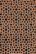 caption: Detail of carved red sandstone Jali Screen on Humayun's Tomb.