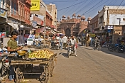 A fruit-seller waits for customers in a bustling street of Bikaner's old quarter.