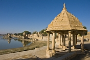 Carved sandstone temples along the edge of the Gadi Sagar built 1367 by Maharaja Gadsi Singh.