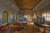 Maharajas bed chamber and huge night-gown in the seven-storey Juna Mahal.