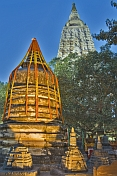 Twilight view of small stupas and the Bo tree of Enlightenment in front of the main Mahabodhi Temple.