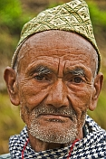 Sikkimese mountain man with traditional hat.