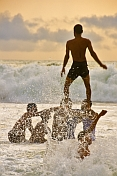 Indian boys playing towers in the surf of the Arabian Sea.