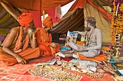 Juna Akhara Naga Shows Guru Picture To Two Sadhus
