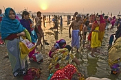 Men And Women Bathe In Ganges River At Dawn