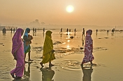 Four Indian Women Walk To The Ganges River At Dawn