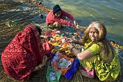 Two Women Prepare Hindu Ceremony By Ganges River