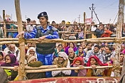 Police Woman With Seated Pilgrims Watch The Basant Panchami Snana Procession