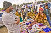 Three Face-Painted Children Look At Kumbh Mela Book Stall