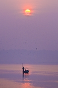 Solitary Boat Visits Sangam On River Ganges At Dawns Early Light