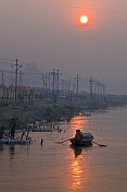 Rowing Boat And Bathing Pilgrims On Ganges Yamuna River At Dawn
