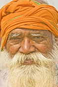 Smiling Hindu Holy Man With Orange Turban And Flowing White Beard