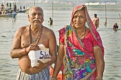 Elderly Indian couple pose after taking their sacred dip in Ganges river.