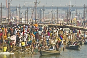 Crowded Bathing Area On The Fast Flowing Ganges River