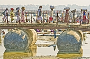 Hindu Pilgrims Carry Belonging On Their Heads As They Cross Ganges River Pontoon Bridge